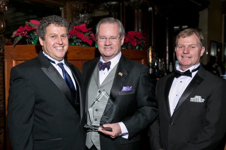 Fred Fortunato (left) and Kevin Whittaker (right) present Kevin Kelly (center) with the Leon N. Weiner Builder of the Year Award