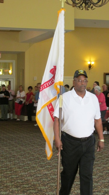 #4 Reggie Valentine carrying Army flag