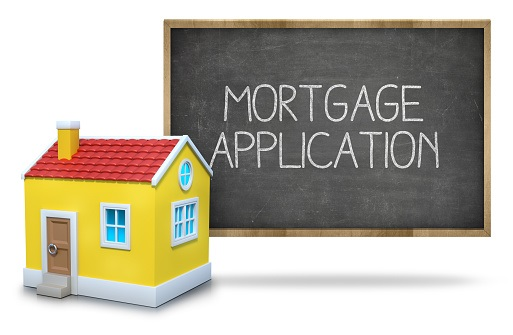 Mortgage application text on blackboard with 3d house